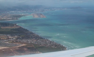 Home again! Arriving at Honolulu International Airport. You can recognize Diamond Head on the